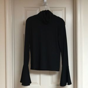 Stretchy, knit turtleneck with bell sleeves